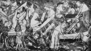 Black death victims being buried