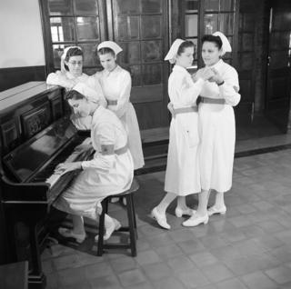 A group of trainee nurses entertain themselves while on a break