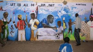 A closeup of the same mural, with a student holding a notebook and pencil, a priest and a woman with a bucket on her head. Also the Dr as described above.