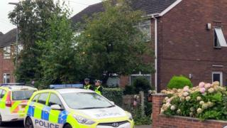 Police at the scene in Greymist Avenue, Woolston, Warrington, Cheshire, following a police counter-terrorism raid where a 31-year-old man was arrested