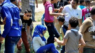 Cairo teenagers harass a girl in a park