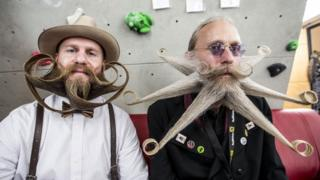 two men with styled beards