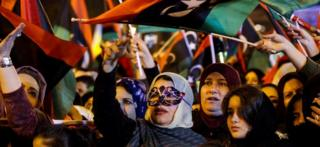 Libyans wave national flags as they attend a celebration marking the seventh anniversary of the Libyan revolution which toppled late leader and strongman Moamer Kadhafi, in the capital Tripoli's Martyrs Square on February 17, 2018.