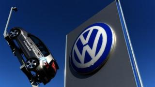 VW sign and car