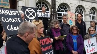 Protesters gathered outside Leeds Civic Hall ahead of the meeting