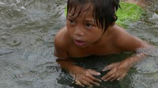 Child in dirty water