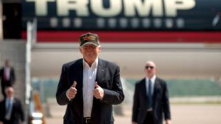 Donald Trump leaving his plane