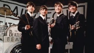 The Beatles on Granada TV in 1963 in front of a camera shaped drum kit