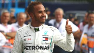 Lewis Hamilton gives a thumbs up