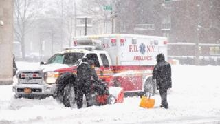 An ambulance gets stuck in the snow