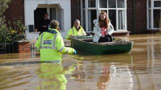 People rescued by boat from their flooded homes in Hereford