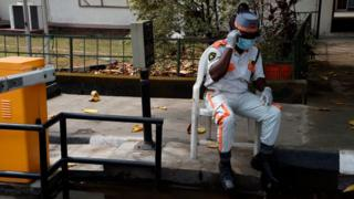 Visitors to one goment hospital collects face masks, hand gloves and have dia hands sanitise as dey walk past di security post entrance in Lagos, on February 28, 2020