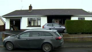 The house where the fire broke out - damage can be seen at the front of the property