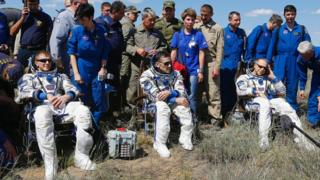 astronauts relax after landing