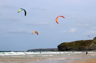 Kite surfers on a beach