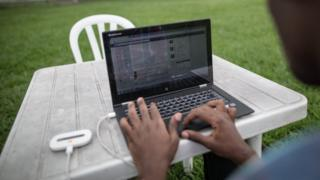 A young African engineer connects his laptop to internet on 25 February 2015.