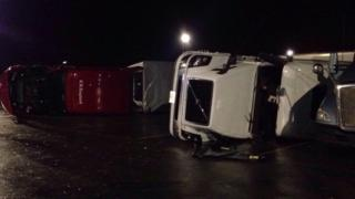 Trucks are seen overturned in the aftermath of the tornado near Circeville, a town east of Dayton, in Ohio