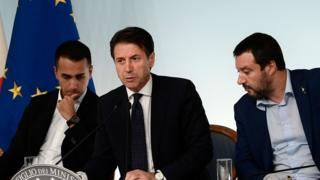File photo: Italy's Deputy Prime Minister Luigi Di Maio, Prime Minister Giuseppe Conte, and Deputy Prime Minister Matteo Salvini, all confer during a press conference