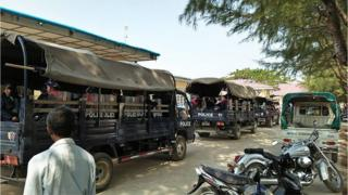 Police trucks in the town of Mrauk U