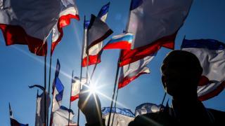 Children hold Crimean flags at Lenin Square in Simferopol, Crimea, Ukraine, 15 March 2014.