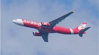 AirAsia plane flying in Malaysia