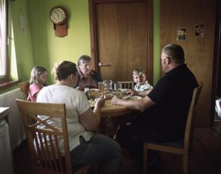 A family talk around their dinner table.