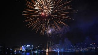 Fireworks light up night sky over Abidjan cityscape