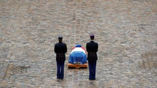 French Republican guards stand in front of the flag-draped coffin of late Gendarmerie officer Colonel Arnaud Beltrame