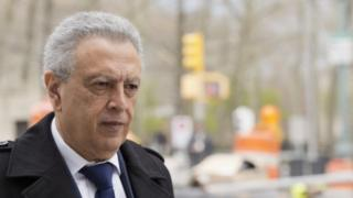 Former Fifa Vice President Alfredo Hawit leaves federal court on Monday (11 April 2016)