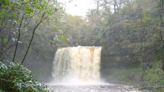 Sgwd yr Eira waterfall in full flow