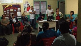 Residents of Monte Carmelo gather to discuss issues affecting their village