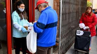 Free food handout for hard-up residents in Madrid, 20 Apr 20