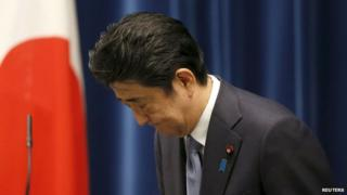 Japan's Prime Minister Shinzo Abe bows as he leaves a news conference after delivering a statement marking the 70th anniversary of World War Two's end, at his official residence in Tokyo, 14 August 2015