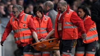 Arsenal's French defender Laurent Koscielny is carried on a stretcher during the UEFA Europa League semi-final second leg football match between Club Atletico de Madrid and Arsenal FC at the Wanda Metropolitano stadium in Madrid on May 3, 2018.