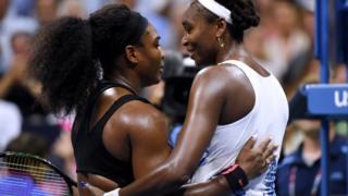 Serena Williams and sister Venus Williams hug at the US Open