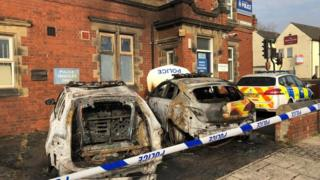 Police cars set on fire