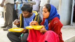 A couple have breakfast at the Indira canteen