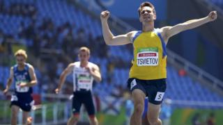 Ihor Tsvietov of Ukraine (left) wins the gold medal in the men's 400m - T54 - race