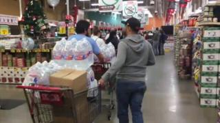 Residents stood in cues past midnight on Wednesday to stock up on bottled water