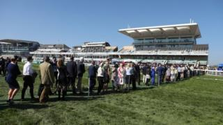 Racegoers arrivefor Grand National Day of the Grand National Festival at Aintree
