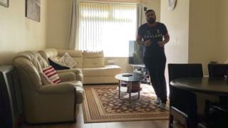 Asif Amirat running around his coffee table