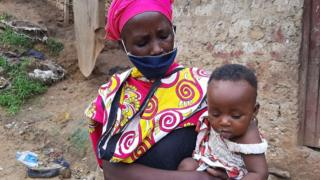 Peninah Bahati Kitsao and one of her children in Mombasa, Kenya