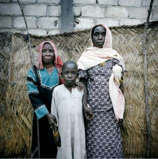 Ali, 15, his mother Amina, 50, and 80-year-old grandmother Aché Mal at a rented home in the outskirts of Mémé,