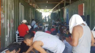 Refugees in Australia's former detention centre on Manus Island