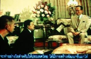 Bangkok, THAILAND: A television grab of Thai King Bhumibol Adulyadej (R), when he urged the then-military government Suchinda Kraprayoon (C) and pro-democracy protesters Chamlong Srimuang (L) to negotiate a settlement and avoid violence at the Royal Palace in Bangkok, 20 May 1992. Opponents of Thai Prime Minister Thaksin Shinawatra prepared another mass rally 13 March calling for him to quit, as an unusual television broadcast of the king bolstered calls for compromise. AFP PHOTO/TV 9 (Photo credit should read AFP/AFP/Getty Images)