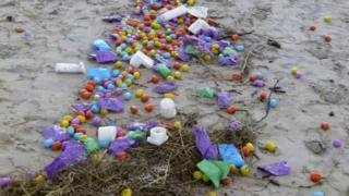 Plastic eggs containing tiny toys (Ueberraschungseie) that were swept ashore at a beach in Langeoog (04 January 2016)