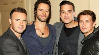 Take That in 2010, with one member missing as they will be on Friday