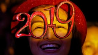 A reveller wears glasses that spell out 2019 during the New Year's Eve party in Quezon City, Metro Manila, Philippines, 31 December 2018