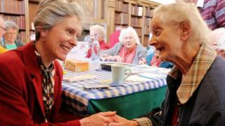 Reverend Canon Dr Jo Bailey Wells with an elderly parishioner