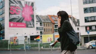 Woman in Cologne with phone